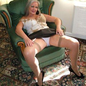 Busty granny strips
