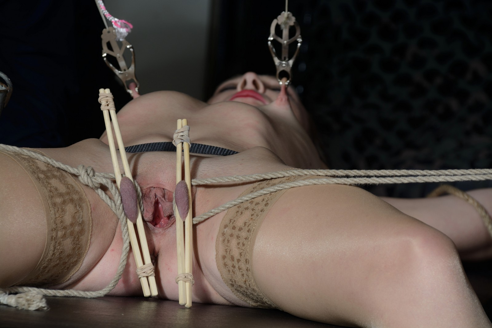 Table tied Lolanis nipple clamps