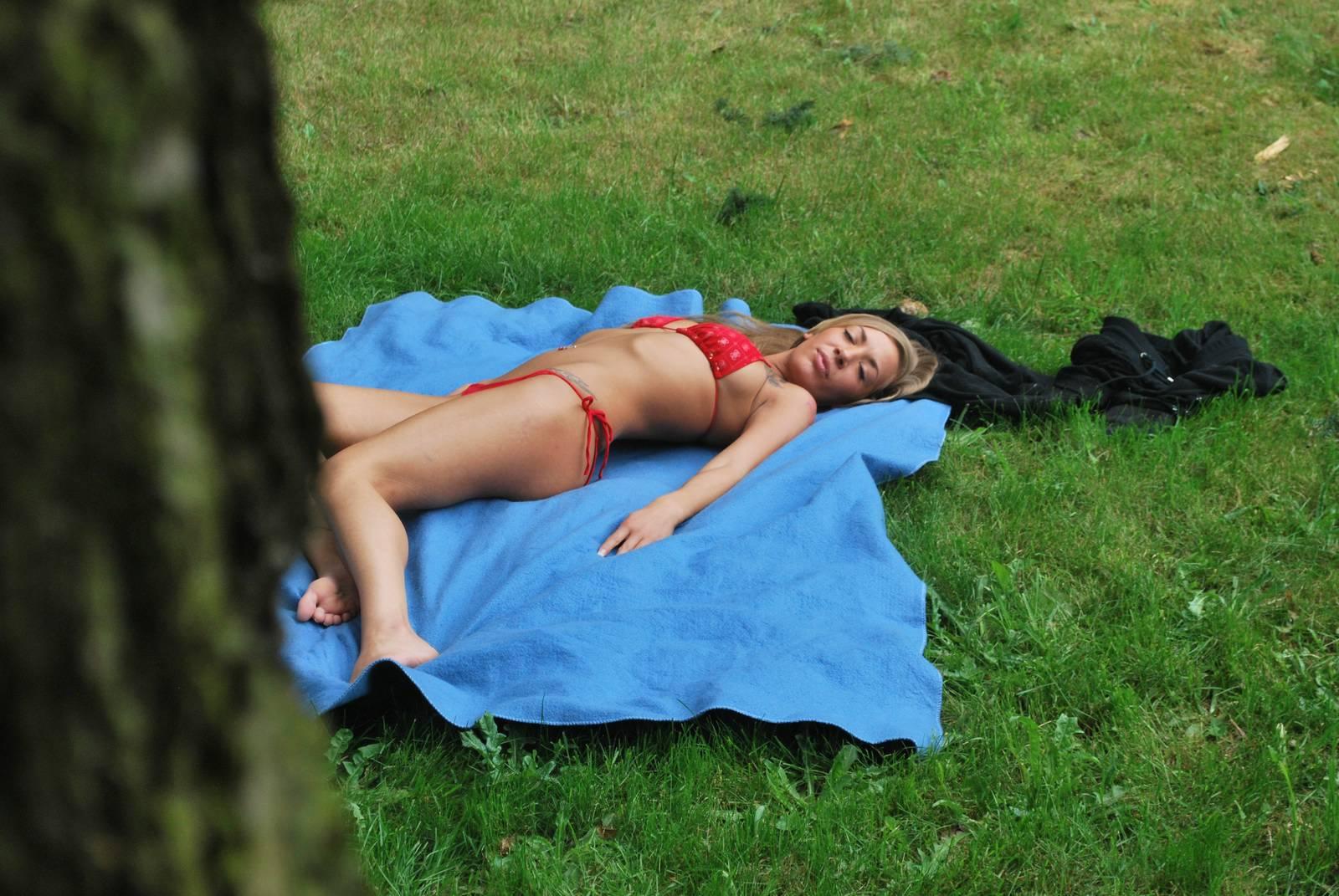 Sexy brunette Megans voyeur sunbathing